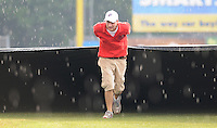 JJuly 17, 2009: A member of the Potomac Nationals grounds crew helps pull the tarp during a rain delay prior to a game against the Kinston Indians at G. Richard Pfitzner Stadium in Woodbridge, Va. Photo by:  Tom Priddy/Four Seam Images