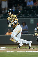 Charles Leblanc (33) of the Down East Wood Ducks follows through on his swing against the Winston-Salem Dash at BB&T Ballpark on May 12, 2018 in Winston-Salem, North Carolina. The Wood Ducks defeated the Dash 7-5. (Brian Westerholt/Four Seam Images)