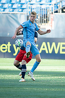 FOXBOROUGH, MA - SEPTEMBER 19: Keaton Parks #55 of New York City FC passes the ball with Thomas McNamara #26 of New England Revolution in pursuit during a game between New York City FC and New England Revolution at Gillette on September 19, 2020 in Foxborough, Massachusetts.