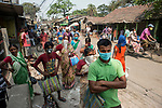 Indian people queue up for ration at a  government controlled shop in New Garia, Kolkata during 21 days lock down in India due to covid 19 pandemic. Kolkata, West Bengal, India. Arindam Mukherjee.
