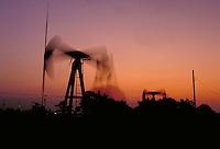 Petroleum industry ; oil ; production ; pumpjack ; domestic ; dusk ; motion ;. Houston Texas.
