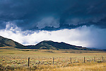 Storm clouds over sage brush flats near Dillon, Montana