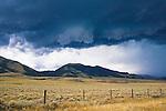 Storm clouds over sage brush flats near Dillon, Montana
