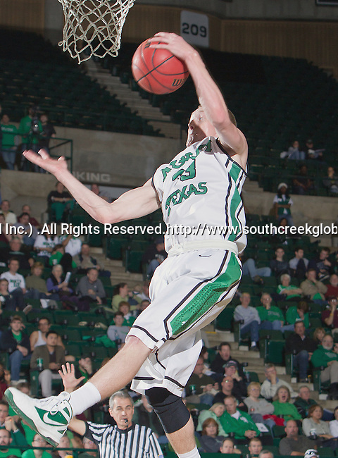North Texas Mean Green guard Tyler Hall (33) in action during the game between the Louisiana Monroe Warhawks and the University of North Texas Mean Green at the North Texas Coliseum,the Super Pit, in Denton, Texas. UNT defeats ULM 86 to 51...