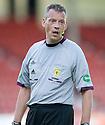 Referee Iain Brines.