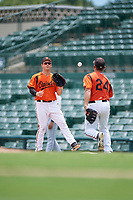 GCL Orioles first baseman Nick DiBenedetto (27) waits to receive a throw from relief pitcher Nick Vichio (24) during a game against the GCL Rays on July 21, 2017 at Ed Smith Stadium in Sarasota, Florida.  GCL Orioles defeated the GCL Rays 9-0.  (Mike Janes/Four Seam Images)