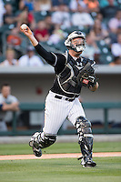 Charlotte Knights catcher Jeremy Dowdy (14) makes a throw to first base against the Columbus Clippers at BB&T BallPark on May 27, 2015 in Charlotte, North Carolina.  The Clippers defeated the Knights 9-3.  (Brian Westerholt/Four Seam Images)