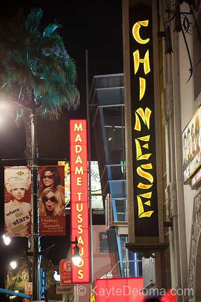 Signs for Grauman's Chinese Theatre and Madame Tussauds on Hollywood Boulevard in Hollywood, Los Angeles, CA