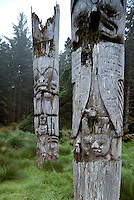 Historic Haida Mortuary Totem Poles at Ninstints (UNESCO World Heritage Site) on Anthony Island (Skung Gwaii), Gwaii Haanas National Park Reserve and Haida Heritage Site, Haida Gwaii (Queen Charlotte Islands), Northern BC, British Columbia, Canada