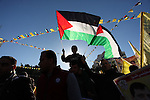 Supporters of the Fatah movement take part in a rally in Gaza City on December 31, 2016, marking the 52nd anniversary of its creation.. Photo by Ashraf Amra