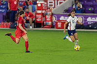 ORLANDO CITY, FL - FEBRUARY 18: Alex Morgan #13 dribbles the ball away from pressure during a game between Canada and USWNT at Exploria stadium on February 18, 2021 in Orlando City, Florida.