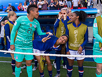 PARIS,  - JUNE 16: PJess McDonald #22 and Megan Rapinoe #15 wait for the game to begin during a game between Chile and USWNT at Parc des Princes on June 16, 2019 in Paris, France.
