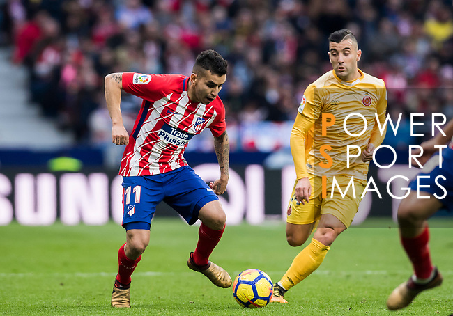 Angel Correa (L) of Atletico de Madrid fights for the ball with Borja Garcia Freire of Girona FC  during the La Liga 2017-18 match between Atletico de Madrid and Girona FC at Wanda Metropolitano on 20 January 2018 in Madrid, Spain. Photo by Diego Gonzalez / Power Sport Images