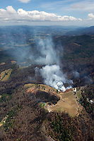 aerial photograph of a controlled burn in the mountaiside of the Mayacamas Mountains, Napa Valley in the background, Napa County, California