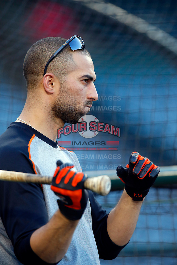 Nick Markakis #21 of the Baltimore Orioles before a game against the Los Angeles Angels at Angel Stadium on May 2, 2013 in Anaheim, California. Baltimore defeated Los Angeles 5-1. (Larry Goren/Four Seam Images)
