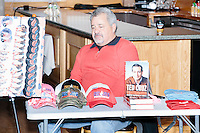 James Bragg, of Dallas, Tex., sells buttons, shirts, hats, and other Cruz merchandise made by My Campaign Wear, before Texas senator and Republican presidential candidate Ted Cruz speaks at a town hall at The Alpine Grove banquet center in Hollis, New Hampshire.