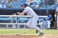 Asheville Tourists third baseman Kyle Datres (3) runs to first base during a game against the West Virginia Power at McCormick Field on June 2, 2019 in Asheville, North Carolina. The  Power defeated the Tourists 5-4. (Tony Farlow/Four Seam Images)
