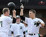 Right fielder Cody Brittain (18) of the University of South Carolina Upstate Spartans, right, is congratulated at home plate by Jake Beaver (11) after hitting a home run in the first inning of a game against the Winthrop University Eagles on Wednesday, March 4, 2015, at Cleveland S. Harley Park in Spartanburg, South Carolina. (Tom Priddy/Four Seam Images)