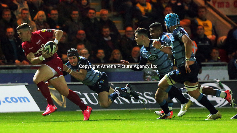Scott Williams of the Scarlets (L) is brought down by Rhun Williams of Cardiff Blues during the Guinness PRO14 match between Scarlets and Cardiff Blues at Parc Y Scarlets Stadium, Llanelli, Wales, UK. Saturday 28 October 2017