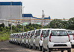 13 September, 2013, Ahmedabad, Gujarat INDIA : Tata Nano motor cars at the new Tata factory on the outskirts of Ahmedabad. Originally the factory was to be built in West Bengal but Tata moved its factory to Gujarat that was more business friendly.  Chief Minister of Gujarat , Narendra Modi has been announced as the Prime Ministerial candidate for the opposition BJP party in the Indian general elections slated for 2014.  One of his great achievements has  been continual supply of power.  Mr.Modi has been a controversial figure since his involvement in the 2002 Gujarat riots where a train full of Hindu pilgrims was attacked by Muslims returning from a disputed temple site in Ayodhya.  In retaliation some estimate up to 2000 Muslims lost their lives in communal violence.   Mr. Modi is alleged to have condoned the violence despite being cleared of any allegations by a Special Investigation Team (SIT) appointed by the Supreme Court of India. Picture by Graham Crouch/New York Times