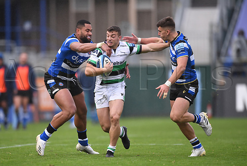 21st November 2020; Recreation Ground, Bath, Somerset, England; English Premiership Rugby, Bath versus Newcastle Falcons; Adam Radwan of Newcastle Falcons is tackled by Joe Cokanasiga and Cameron Redpath of Bath