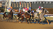 Mudflat (gray) and Vegas No Show (orange noseband) for the early lead in the Jerome as eventual winner Vyjack (in the pink cap) saves ground in tight along the rail.