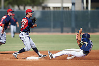 Cleveland Indians Mark Mathias (23) turns a double play as Trent Clark (2) slides in during an instructional league game against the Milwaukee Brewers on October 8, 2015 at the Maryvale Baseball Complex in Maryvale, Arizona.  (Mike Janes/Four Seam Images)