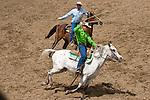 Cowboys swing their lassos ready to rope at the Jordan Valley Big Loop Rodeo, Ore..