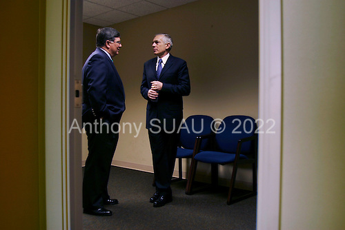 Rock Hill, South Carolina.USA.Jaunuary 29, 2004..General Wesley Clark meets with the Mayor of Rock Hill Doug Echols at the airport where he announces his supporrt for Clark.