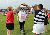 Pictured: A South Wales Police PCSO prepares to take part in Cardiff, Wales, UK. Wednesday 24 August 2016<br />Re: The largest rugby scrum has been achieved by Golden Oldies at University Fields in Cardiff south Wales, UK. It was refereed by welsh international referee Nigel Owens. Guinness World Records has verified the new record in which 1297 people took part in.