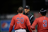 Lowell Spinners manager Luke Montz (30) argues a call with umpire Jon-Tyler Shaw during a NY-Penn League Semifinal Playoff game against the Batavia Muckdogs on September 4, 2019 at Dwyer Stadium in Batavia, New York.  Batavia defeated Lowell 4-1.  (Mike Janes/Four Seam Images)