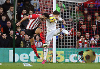 Pictured L-R: Graziano Pelle of Southampton and Federico Fernandez of Swansea (R) defending Sunday 01 February 2015<br />