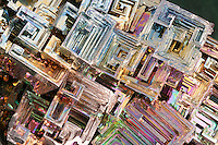 BISMUTH<br /> Brilliant Iridescence Due to Tarnish<br /> Bismuth is a post-transition metal, often occurring in a distinct stair-stepped pattern due to the faster growth rate of exterior edges of the crystal form. An iridescent oxide tarnish can be seen; varied thicknesses of the tarnish reflect different hues.
