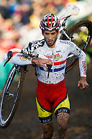 29 NOV 2014 - MILTON KEYNES, GBR - Ian Field (GBR)  from Great Britain carries his bike on his shoulder as he runs over a muddy stretch of the course during the men's 2014-2015 UCI Cyclo-Cross World Cup round at Campbell Park in Milton Keynes, Great Britain (PHOTO COPYRIGHT © 2014 NIGEL FARROW, ALL RIGHTS RESERVED)