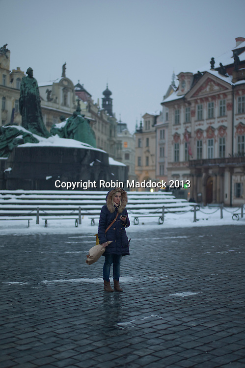 girl waiting for a date , prague old square