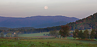 A full moon rises above the mountains during the twilight hours in Albemarle County,VA. Photo/ Andrew Shurtleff