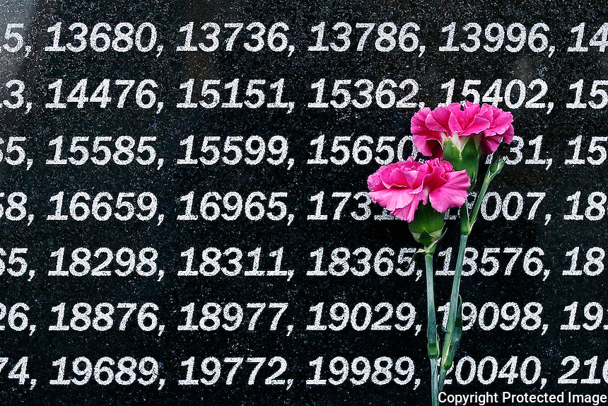 """A memorial in Ivankiv, Ukraine, lists the platoon numbers for all the Ukrainian liquidators who served in the Chernobyl clean up. Locally, residents refer to Chernobyl as """"the war.""""  <br /> ------------------- <br /> This photograph is part of Michael Forster Rothbart's After Chernobyl documentary photography project.<br /> © Michael Forster Rothbart 2007-2010.<br /> www.afterchernobyl.com<br /> www.mfrphoto.com <br /> 607-267-4893 o 607-432-5984<br /> 5 Draper St, Oneonta, NY 13820<br /> 86 Three Mile Pond Rd, Vassalboro, ME 04989<br /> info@mfrphoto.com<br /> Photo by: Michael Forster Rothbart<br /> Date:  10/2008    File#:  Canon 5D digital camera frame 9740<br /> ------------------- <br /> Original caption: .None"""
