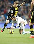 Real Madrid's Cristiano Ronaldo against Real Zaragoza's Glenn Loovens during La Liga Match. November 03, 2012. (ALTERPHOTOS/Alvaro Hernandez)