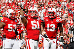 Nebraska LB #51 Will Compton, #53 Thad Randle and #13 P.J. Smith looking up at the student section trying to get some noise along with the 85,000 in attendance at Memorial Stadium in Lincoln, NE vs. Arkansas State on 9-15-12.