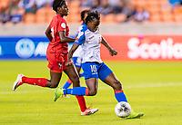HOUSTON, TX - FEBRUARY 3: Nerilia Mondesir #10 of Haiti takes a shot during a game between Panama and Haiti at BBVA Stadium on February 3, 2020 in Houston, Texas.