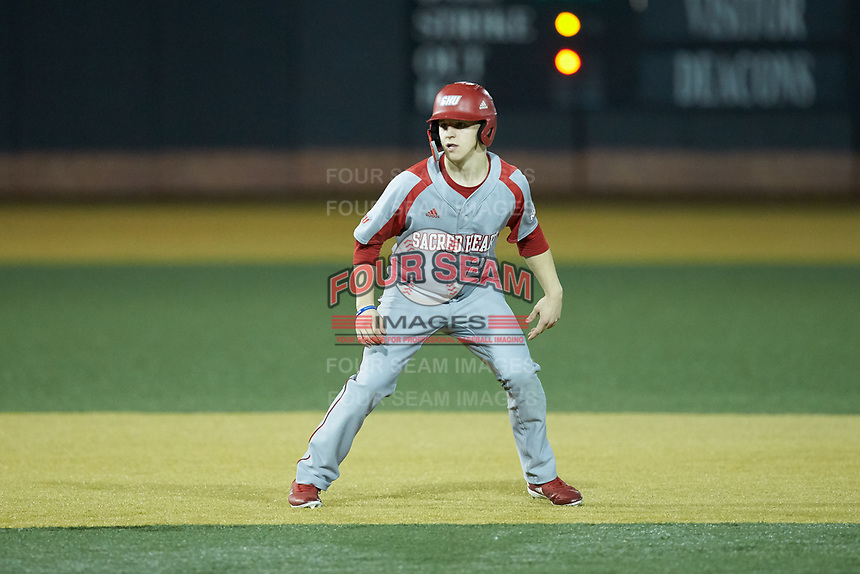 Justin Jordan (22) of the Sacred Heart Pioneers takes his lead off of second base against the Wake Forest Demon Deacons at David F. Couch Ballpark on February 15, 2019 in  Winston-Salem, North Carolina.  The Demon Deacons defeated the Pioneers 14-1. (Brian Westerholt/Four Seam Images)