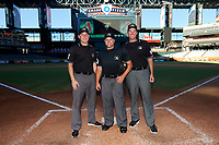 Umpires Skylar Shown, John Mang, and Nate Tomlinson before an Instructional League game between the Oakland Athletics and Arizona Diamondbacks on October 15, 2016 at Chase Field in Phoenix, Arizona.  (Mike Janes/Four Seam Images)
