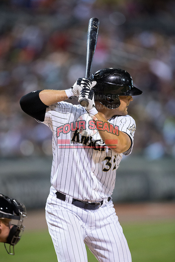 Kevan Smith (32) of the Charlotte Knights at bat against the Norfolk Tides at BB&T BallPark on April 9, 2015 in Charlotte, North Carolina.  The Knights defeated the Tides 6-3.   (Brian Westerholt/Four Seam Images)