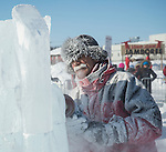 Ice carver covered in snow and ice at Yellowknife's long john Jamboree.