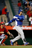 Adrian Gonzalez #23 of the Los Angeles Dodgers bats against the Los Angeles Angels in both teams final spring training game at Angel Stadium on March 30, 2013 in Anaheim, California. (Larry Goren/Four Seam Images)