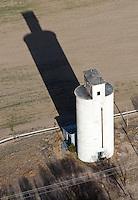 Silo with long shadow. Granada, Colorado.  April 2013.  84801