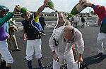Jerry LaSala is doused with champaign from fellow jockeys after LaSala ran his last race as a jockey Saturday at Arlington Park.
