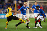 SYDNEY, AUSTRALIA - JULY 31, 2010: Steven Naismith of Rangers evades a tackle by Gentzoglou Savvas of AEK Athens during the match between AEK Athens FC and Glasgow Rangers at the 2010 Sydney Festival of Football held at the Sydney Football Stadium on July 31, 2010 in Sydney, Australia. (Photo by Sydney Low / www.syd-low.com)