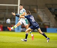 20th November 2020; AJ Bell Stadium, Salford, Lancashire, England; English Premiership Rugby, Sale Sharks versus Northampton Saints;  James Grayson of Northampton Saints kicks downfield under pressure from  Sam James of Sale Sharks