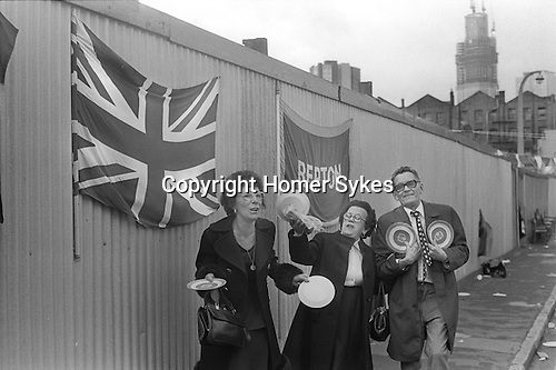 Whitechapel, London. 1977<br /> Repton street, Tower Hamlets, residents sing along at the end of their Silver Jubilee street party. <br /> <br /> <br /> My ref 13/2058/,1977,